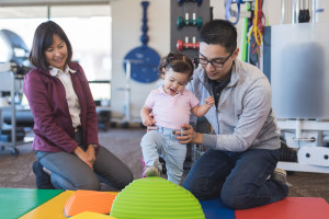 Occupational therapist doing play therapy with a toddler-age girl