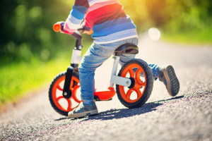 child on a balance bike