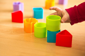 child playing with toy blocks